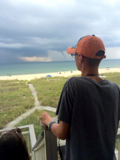 Storms of life in the distance during vacation before we come crashing into reality.